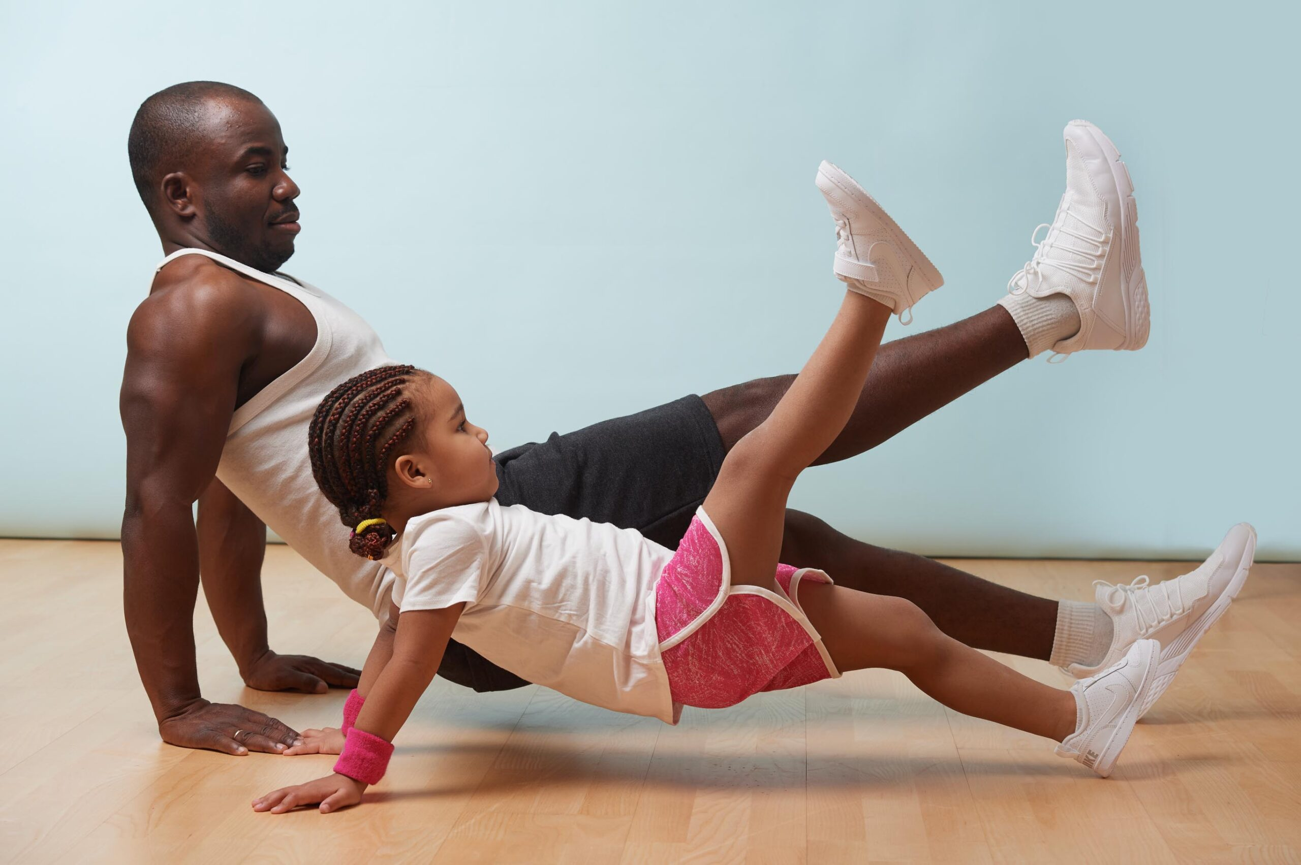father and daughter doing yoga